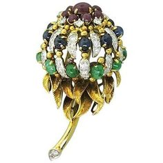Remarkable 18K yellow gold clip brooch, circa 1960s. Brooch features approx. 1.50ctw of VS/G-H diamonds, 1.20ctw of ruby cabochons, 1.20ctw of Sapphire cabochons and approx. 1.40ctw of Emerald cabocho