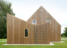 Wooden house extension in Brussels featuring a V-shaped roofline.