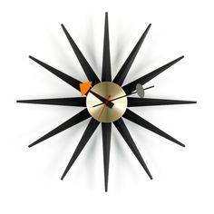 "George Nelson Sunburst Clock Belief in progress and growing economic prosperity were central aspects to the American way of life in the 1950's. Everything seemed possible and people strove to be ""mode"