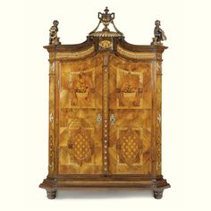 An Austrian carved giltwood, painted faux walnut, fruitwood inlaid marquetry and parquetry walnut schrank circa 1770 Louis Xvi Style, Carving, Furniture, Fine Furniture, Louis Xvi, Furniture Accessories, World Of Color, European Furniture, Beautiful Cabinet
