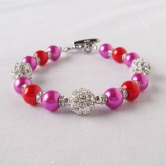 Two Toned Fucshia and Red Pearl Bracelet with Alloy by fayeslipp
