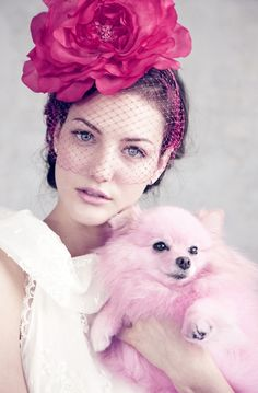 pretty girl with flowers in her hair and pink puppy dog