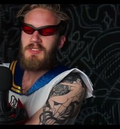 PewdiePie's Shoulder Tattoo #felix #kjellberg #tattoos #badass #arm #tattoo #poods #pewds #skeleton #woman #sailormoon #senpai #YouTube