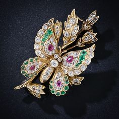 """Diamond, Emerald and Ruby Butterfly Brooch. """"A truly gorgeous and glittering multicolored butterfly has alighted for a brief moment on a diamond-studded branch in this sublime Victorian brooch, masterfully created in rich and warmly patinated 18 karat gold. Ah, the wonders of nature! Just a tad shy of 1 and 1/2 inches long by 7/8 inch wide."""""""