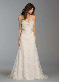 Ivory English net and Chantilly lace over Champagne charmeuse slim gown with blouson bodice. Sheer sweetheart neckline, beaded spaghetti straps and embroidered and jeweled accents throughout.