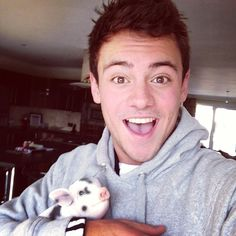 Tom Daley and a teacup pig...they are both cute!!