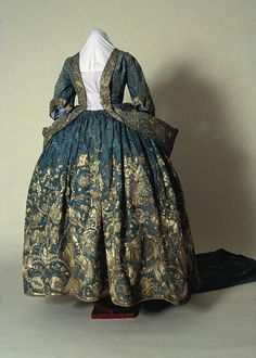 Court mantua and petticoat, 1720s. Light blue satin damask heavily embroidered with silver thread. The mantua has been altered and most of the train has been cut away; the petticoat is unaltered. From the Morgan family of Tredegar Park, Monmouthshire. Possibly worn by Lady Rachel Cavendish after her marriage to Sir William Morgan in 1720.