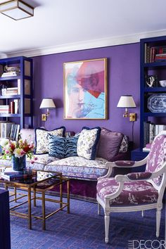 In the library of the Upper East Side apartment Alex Papachristidis designed for Samantha Rudin Earls and David Earls, the custom sofa is upholstered in a Manuel Canovas velvet with cushions in a Brunschwig & Fils cotton; the Louis XVI armchair is covered in a Braquenié fabric, the custom carpet is by Beauvais, the print is by Andy Warhol, and the walls are sheathed in a Manuel Canovas lambswool.