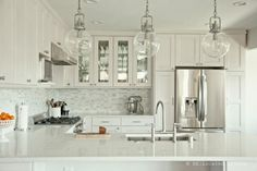 Gorgeous kitchen remodel using Ikea cabinets!  cool before and after.  What a difference.