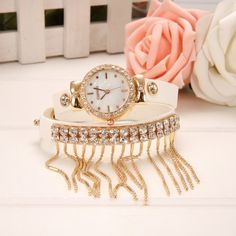 5 Colors for your choice: White, Red, Purple, Blue, Black Material: Synthetic Leather + Metal + Glass Watch dial diameter: 2.7cm Bracelet length: 39cm Clasp: Buckle Bracelet Style: Casual, Fashion Des