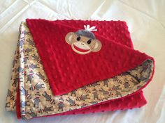 Just ordered this for Baby Sawyer. Love it! Sock Monkey Applique Minky Blanket by TweetDreamsBoutique on Etsy