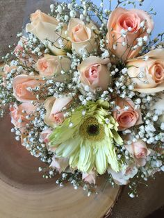 Bridal bouquet vintage peach roses and baby breath