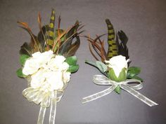 Feathered Keepsake wrist corsage made to match a camo vest for prom. Made by Designer Flair Boutique on Facebook.