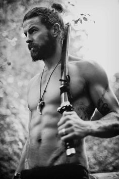 Dear shirtless man with beard and weapon.  Please save me from the savages. Love,  Damsel