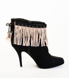 Sharon shares her secret style shown with beige suede fringe framed by black trim with tiny silver chains.