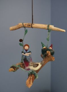 This Waldorf inspired mobile is entirely handmade and one of a kind. All the materials are natural: drift wood, wool fiber and felt, pine cones.