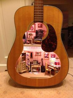 Miniature doll house repurposed old acoustic guitar body