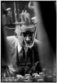 Henri Cartier-Bresson   In a shop selling Sudanese ivory, American looking at the show window, Cairo 1950