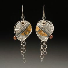 Wendy Thurlow- light as a feather earrings. Silver and 22k gold.