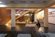 floating stairwell with pillars and glass panels pebble look rug and furnishings