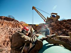 Inspections by the U.S. safety agency found TransCanada wasn't using approved welding procedures to connect pipes, the letter said. Above, w...