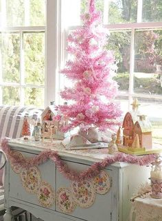 Thinking of paring down my Christmas decor - like this simple idea - but prob choose a green or white tree