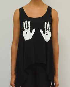 be deliciously mischievous with this provocative and funny tank.