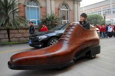 Google Image Result for http://assets.inhabitat.com/wp-content/blogs.dir/1/files/2011/03/Electric-Shoe-Car-by-Ao-Kang-537x358.jpg