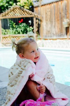 The softest snow leopard minky blanket to wrap around this sweet face. In the perfect size that is just big enough for a little one. Thank you Ramshackleglam for sharing this lovely picture!   Shop our collection for babies. KVH by Kelly Van Halen.  https://www.kellyvanhalen.com/collections/baby-children