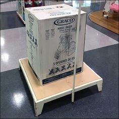 This Minimalist Graco Display Platform As Plinth defines a space and display in a way the mere boxed item alone could not. An upright sign stand is also. Retail Merchandising, Minimalist, Platform, Display, Storage, Metal, Wood, Crafts, Home Decor
