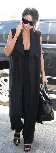 Selena Gomez: Vest – Camilla and Marc  Purse Prada  Shoes – Kurt Geiger