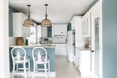 Aegean Teal - pony wall and hanging sonces between lr & kitchen