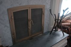 custom bronze fireplace screen & tools by Ben Westbrook