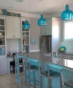 Beachy blue kitchen. Blue kitchen island and blue glass pendant lights.