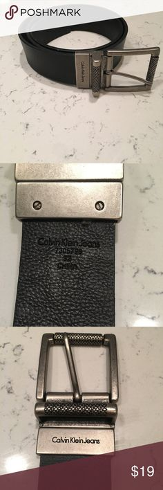 CALVIN KLEIN Reversible Leather Belt Size 32 CALVIN KLEIN Reversible Leather Belt. EUC. Black and brown reversible style in size 32 with silver hardware. RN 7305796 for authenticity. Calvin Klein Jeans Accessories Belts