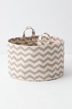 "Mountain Peaks Bath Basket, Short. Transforming everyday storage into a decorative piece, this printed cotton canvas basket adds to the aesthetic of your bathroom or laundry room. No need to tuck it away in a linen closet - show it off and fill it to the brim with your towels, styling tools, extra paper products and more. By Lovell.  Cotton, plastic; self lined.  Spot clean.  12""H, 18"" diameter.  Canada.  #093615  $88.00  Dark Grey"