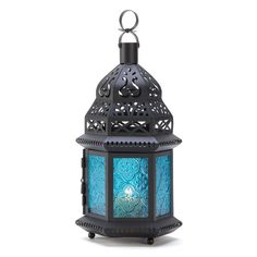 Blue Glass Candle Lantern Ocean blue is the color of serenity beautifully showcased in this intricate metalwork Moroccan lantern. Ornate cutouts allow a candle's golden light to provide a fascinating