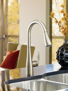 Moen 7594SRS Spot Resist Stainless Kitchen Faucet - This sleek faucet features a pause button that allows you to interrupt the water flow while moving the spout outside the sink. How cool is that!