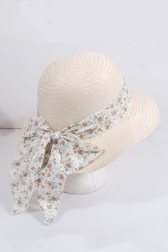 Plaited hat with floral print bow-knot crafted in straw, featuring the round crown, floral print to bow-knot, straw plaited design, country style and sweet.