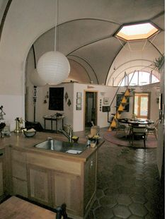 dome home open plan kitchen to living room with a great skylight accent above. Ceci n'est pas un 'quanset hut'