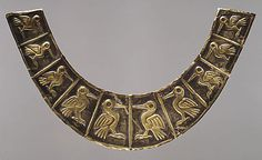 Nose Ornament Fragment    Date:      1st–3rd century  Geography:      Peru  Culture:      Moche (Loma Negra)  Medium:      Gold-partially silvered  Dimensions:      H. 4 3/4 x W. 8 1/4 in. (12.1 x 21 cm)   Classification:      Metal-Ornaments