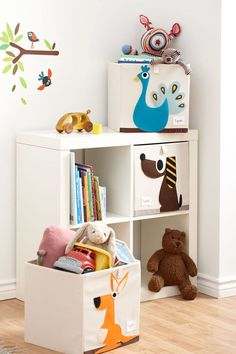 Awesome - cheap IKEA bookshelf plus 3 Sprouts storage bins. Maybe leave two shelves open for books?: