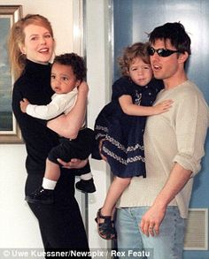 Life after Tom: Nicole now rarely sees her children Connor and Isabella, pictured left in 1996.