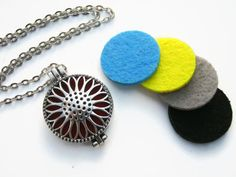 SunFlower Diffuser Necklace Aromatherapy by Abundantearthworks  #sunflower #sunflowernecklace #diffuser #diffusernecklace #aromatherapy #aromatherapynecklace #essentialoildiffuser #flowernecklace #personalizednecklace #abundantearthworks