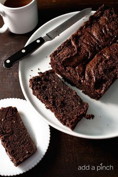 Chocolate Zucchini Bread makes a moist, delicious recipe perfect for serving for breakfast, brunch, a snack or even dessert! // addapinch.com
