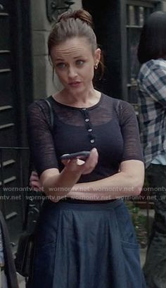 Rory's navy henley top and circle skirt on Gilmore Girls: A Year in the Life. Outfit Details: https://wornontv.net/63626/ #GilmoreGirls