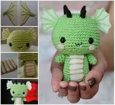 This super cute Amigurumi Baby Dragon Crochet Pattern is perfect for your next project and it's free. Check out the video tutorial too. Crochet Dragon Pattern, Crochet Cross, Diy Crochet, Crochet Dolls, Crochet Baby, Crochet Ideas, Crocheted Toys, Knitting Projects, Crochet Projects