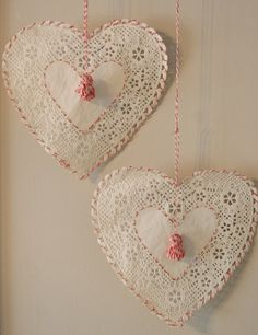 Inspire Bohemia: Stitch around paper doilies with two toned thread or string and hang as ornaments