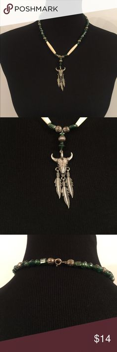 """Cow Skull Beaded Necklace EUC with green and silver beads   Three feathers adorn the skull. It measures approximately 20"""" long laid flat and the skull pendant measures approximately 2.5"""" long from top of skull to tip of feather it measures approximately.75"""" wide horn to horn Jewelry Necklaces"""
