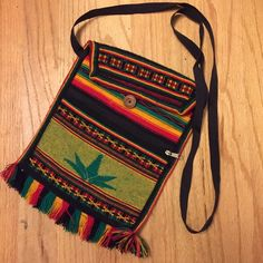 Rasta Shoulder Purse Vintage rasta purse with strap. Purchased at a street fair. Has one button closure and a separate zipper pocket. No brand. Good condition, some piling on the back. Bags Crossbody Bags
